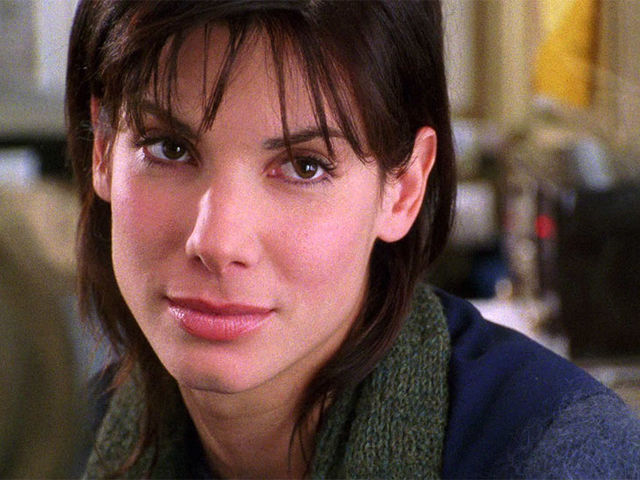 Who does Sandra Bullock play in While You Were Sleeping?