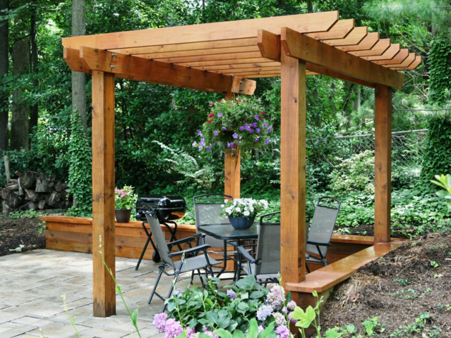A pergola is an outdoor structure, usually found in a yard or park, composed of columns supporting a roof of beams or rafters.