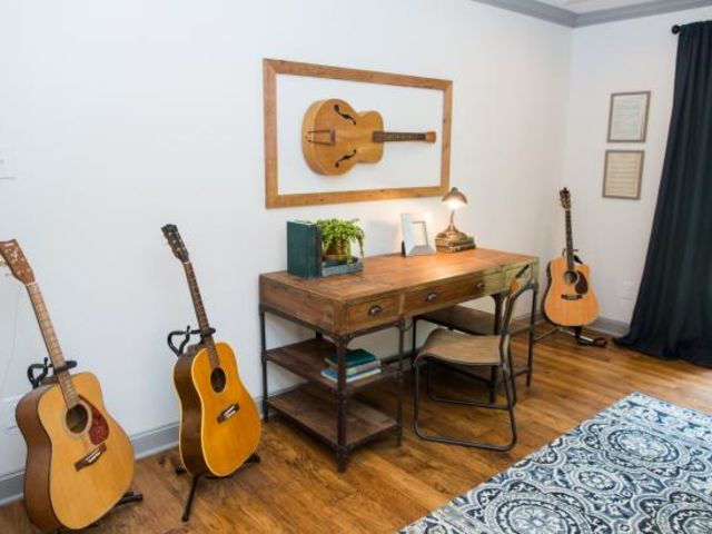 What do you call the framed guitar on the wall?