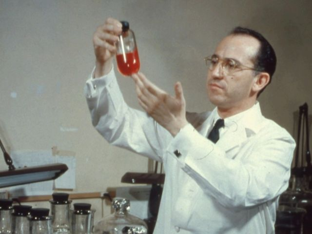 This man is Jonas Salk, and he cured: