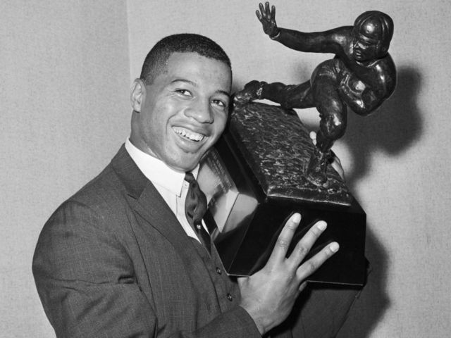 Davis won the Heisman while playing at Syracuse in 1961.