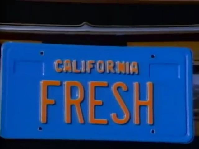 The license plate said fresh and had ______ in the mirror