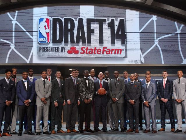 Which lengthy small forward found his way to the 2nd pick in 2014?