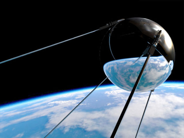 What year did the Russians launch the first artificial Earth satellite, Sputnik?