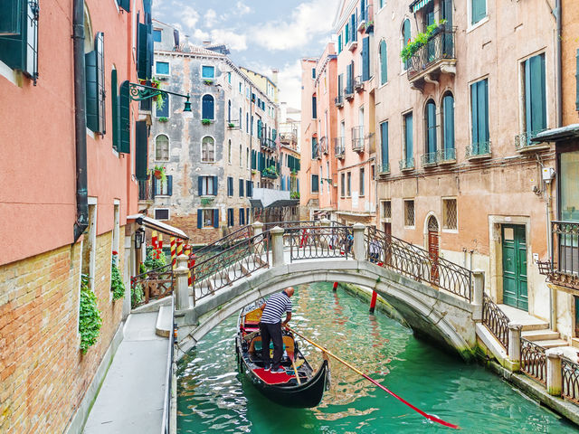 It's beautiful Venice! Take a ride along the canal in a gondola or get lost in the maze of glorious tiny alleyways, it won't disappoint.  Plan your trip - Top 10 Venice hotels:   http://top10.co/gVHl2xq
