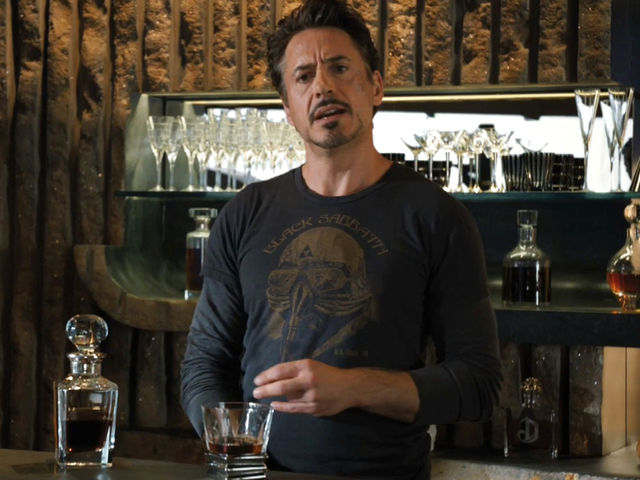 "While conversing with Loki in ""The Avengers"", Tony Stark is wearing a T-shirt featuring which band?"