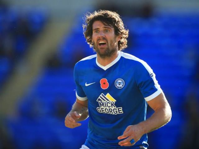 This is Peterborough United's Michael Bostwick, but how did he make a right old fool of himself in his side's 1-0 win over Northampton in November?