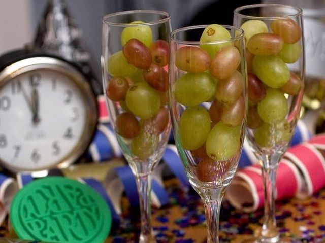 Each person eats 12 grapes, one on each stroke of the clock at midnight, to bring good luck in the coming year, one for each month.