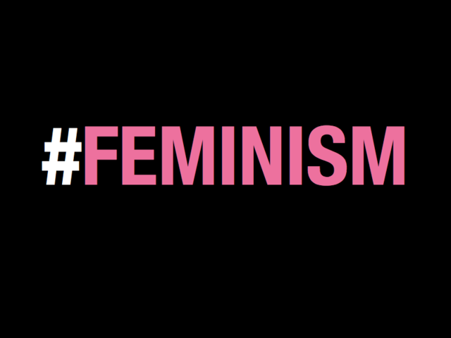 "Which famous current singer performed with the word ""FEMINIST"" as part of her background on stage?"