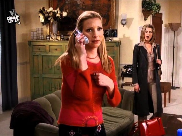 What caused the fire in Rachel and Phoebe's apartment?