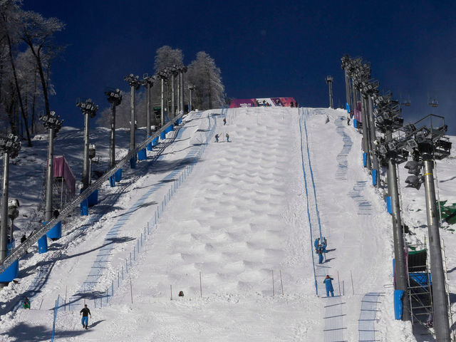While it is not currently an Olympic event, who wouldn't want to watch moguls snowboarding?