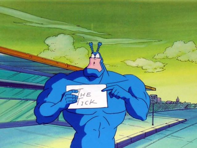 Which comic book store was the tick originated as a mascot for?