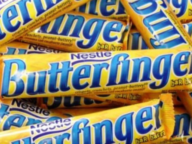 That was a butterfinger! You can tell by the flatness of the bar with ridges of crunchy candy causing ripples.