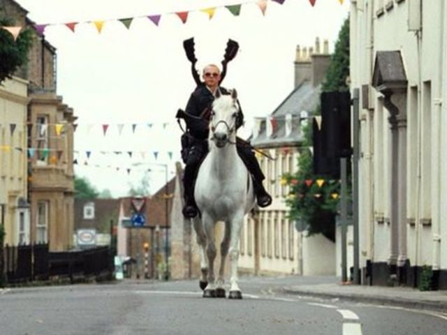 "In ""Hot Fuzz,"" Nicholas Angel is transferred to the village of Sandford, in what county?"