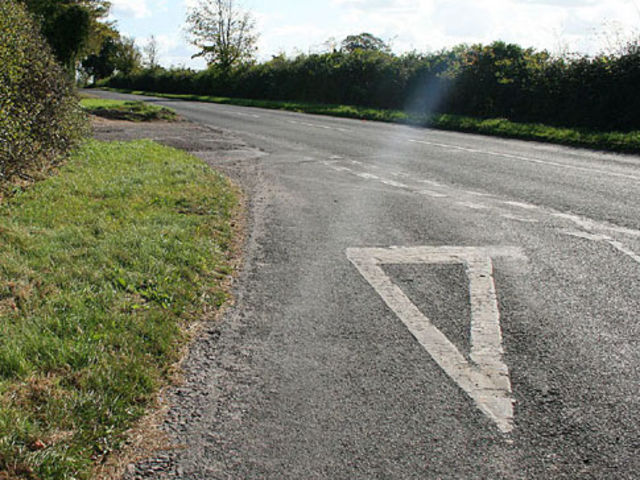 What Does White Triangle Painted On The Road Before Junction