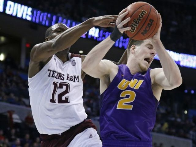 In addition to the Texas A&M-UNI match-up, what was the other classic second round game that featured a last second tip-in?