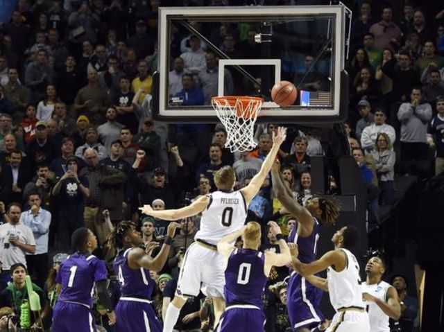 Notre Dame's Rex Plfueger scored his only two points of the game with a tip-in at the buzzer.