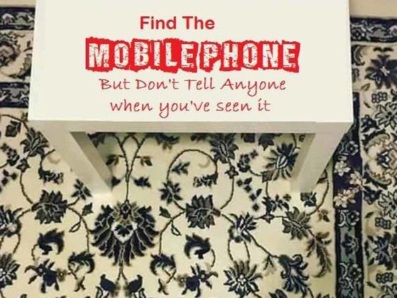 Can you spot the phone on the rug?