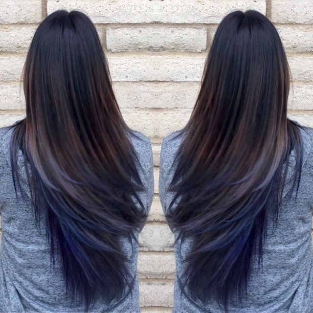 Close Up Shot Of Woman With Black Hair Blue Tips Posing In A