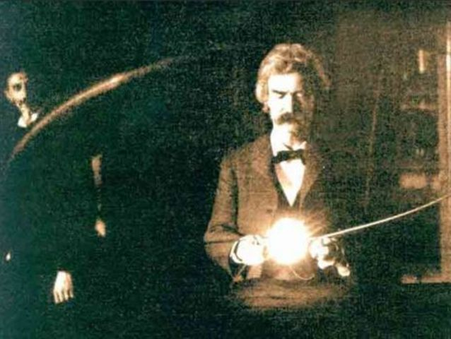 This incredible photograph shows Mark Twain visiting the laboratory of: