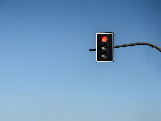 Red can mean many other things. In British culture (and many others) it also means stop - like the red in traffic lights.