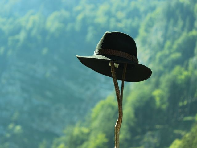 It's a good idea not to wear a green hat in China because it might mean: