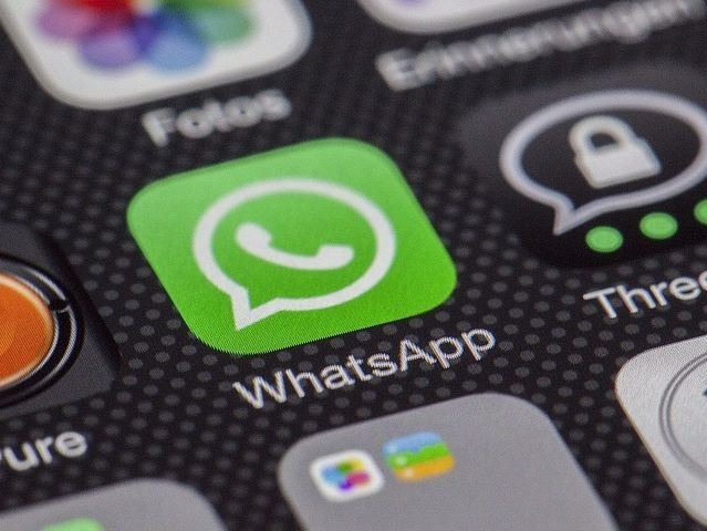What is the minimum age to sign up for WhatsApp?