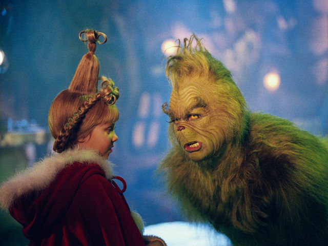 How does the Grinch travel between his hideout and Whoville?