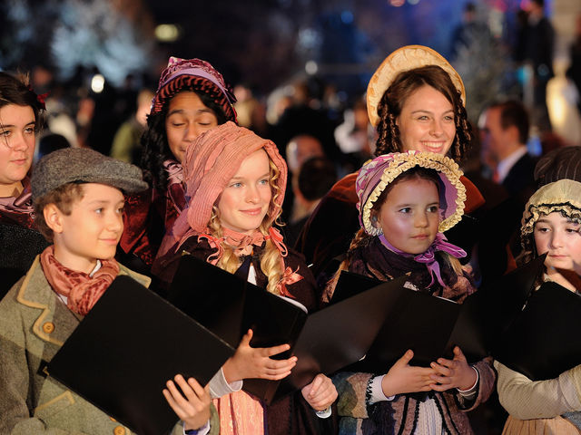 What are these semi-enthused children in Dickensian garb doing?