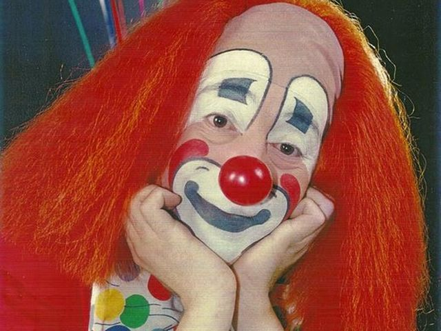 Which serial killer performed as Pogo the Clown at parties and charitable events?