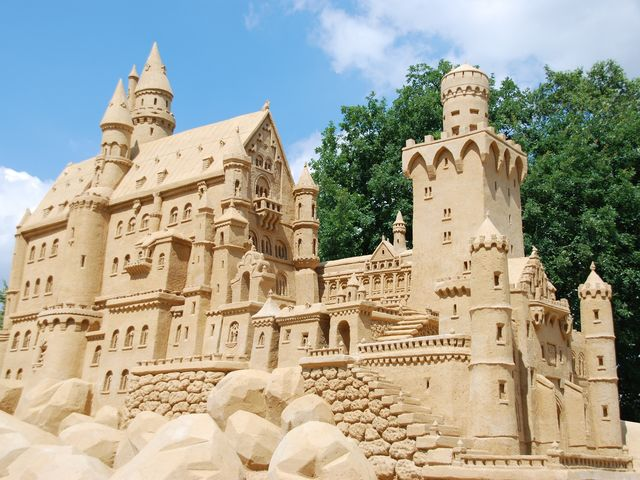 What State College festival features a giant sand sculpture?