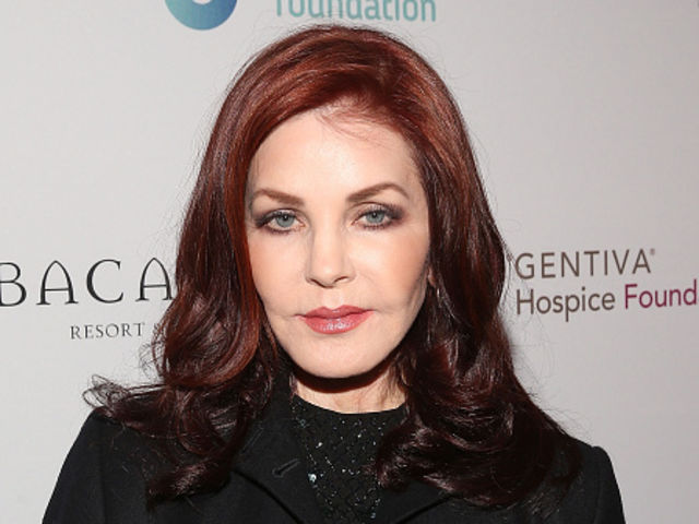 What lawyer was tied romantically to Priscilla Presley?