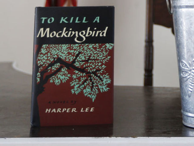What is the most commonly cited reason why Harper Lee's Pulitzer Prize-winning To Kill a Mockingbird is banned by schools and libraries?