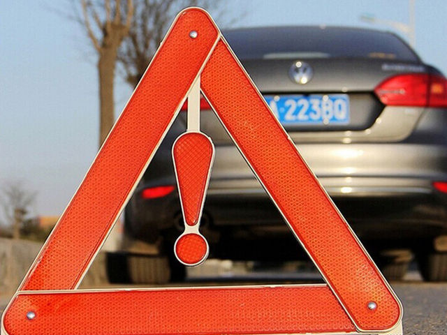 An orange triangle on the back of a vehicle indicates that the vehicle...