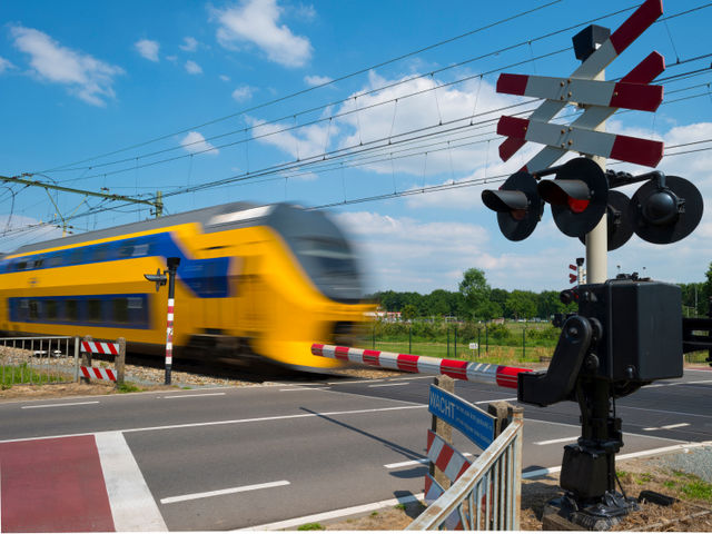 Flashing red lights typically mean a train is approaching; you do not have the right-of-way.