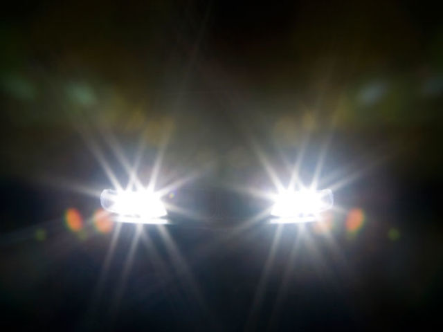 Headlights are mandatory when other cars can't be seen within 1000 feet.