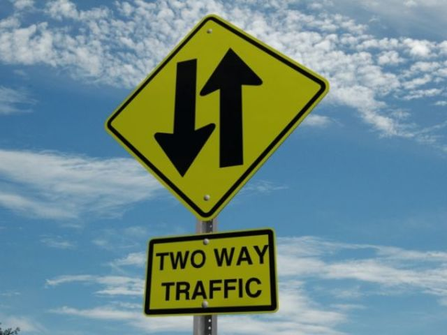 The other signs represent a divided highway and a merge.