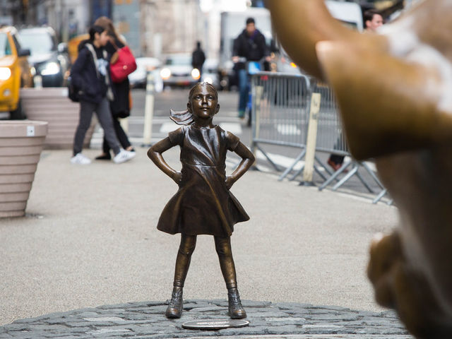 "No stranger to controversy, Wall Street's ""Fearless Girl"" statue had what placed next to it by a frustrated artist this week?"