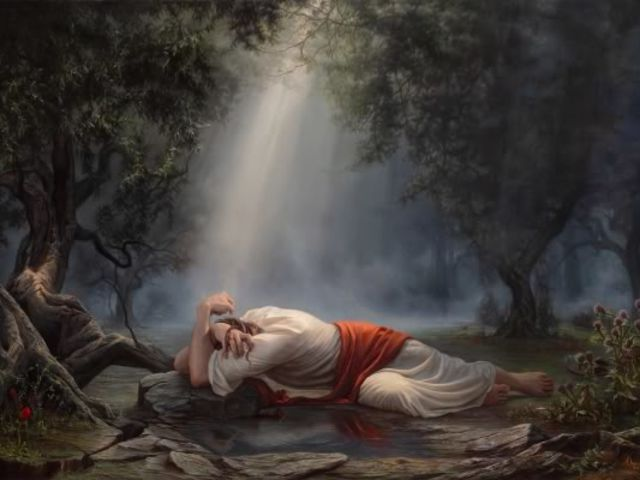 When Jesus is praying in the Garden of Gethsemane, what does God send to comfort him in his agony?