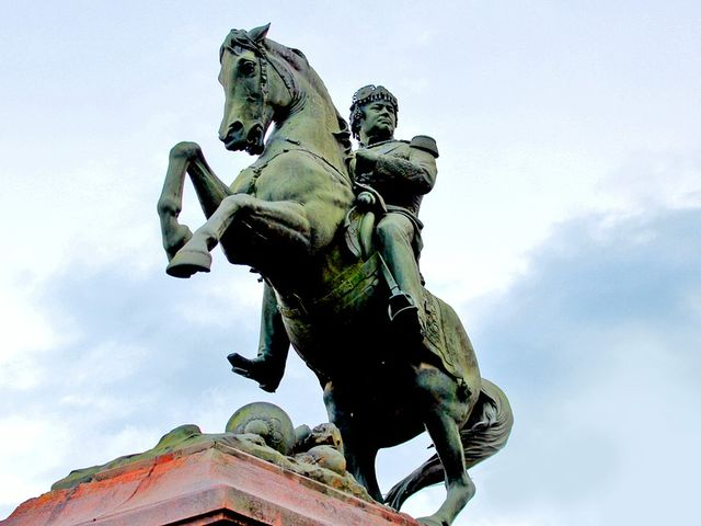 13. What is the meaning of a horse statue with its legs raised in the air?