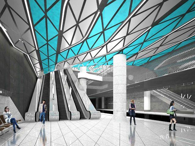 Ну а здесь в дизайне будет преобладать тема воды. Станцию оформят в бело-голубых тонах, потолок облицуют цветным металлом, а кольцевые светильники на потолке будут имитировать расходящиеся по воде круги...