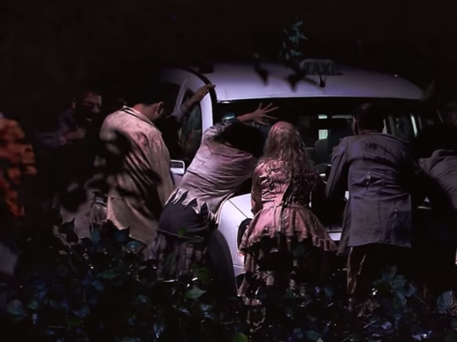 As you're traveling down the open path, three zombies manage to ambush your vehicle. One is on the hood of the car, and there's one at each of the side rear windows. In which order to you try to shoot the zombies?