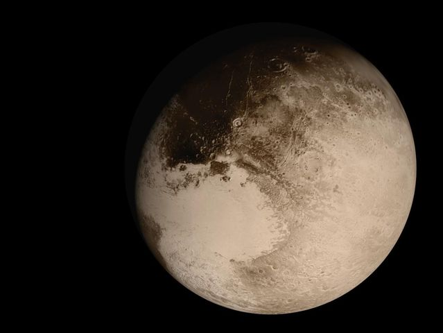 What year was Pluto booted out of the solar system?