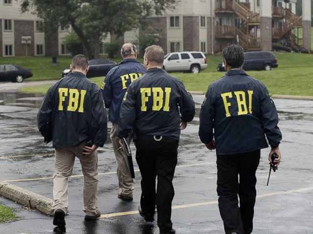 Which gangster turns out to be an FBI informant?