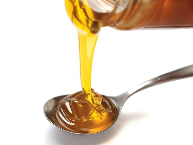 How many bees does it take to produce one tablespoon of honey?
