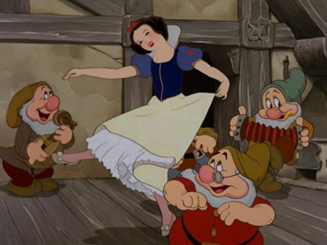 What wish does Snow make before she goes to bed at the dwarfs cottage?