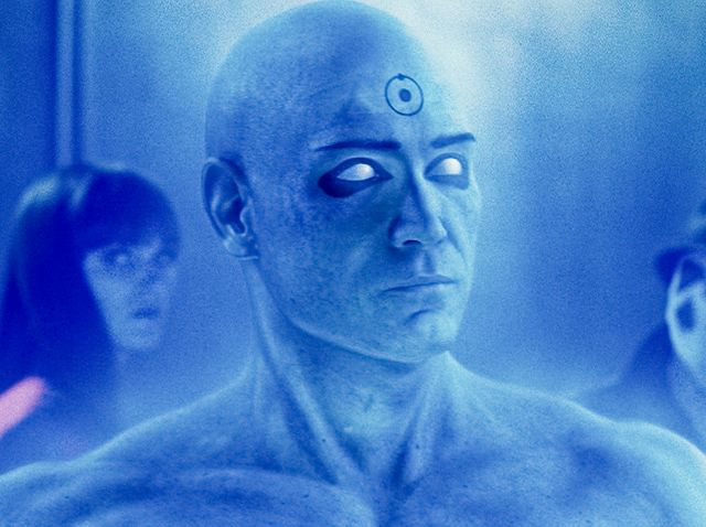 Is Dr. Manhattan an introvert or an extrovert?