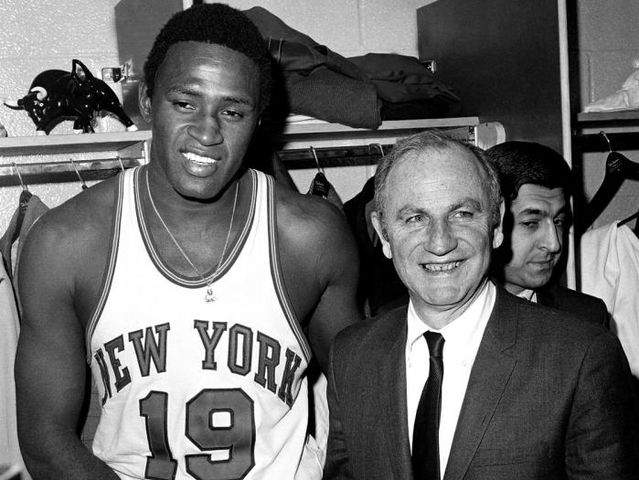 The Knicks honored Red Holzman by retiring what number?