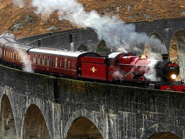 Which compartment of the Hogwarts Express did Slughorn invite Harry and Neville to have lunch in?