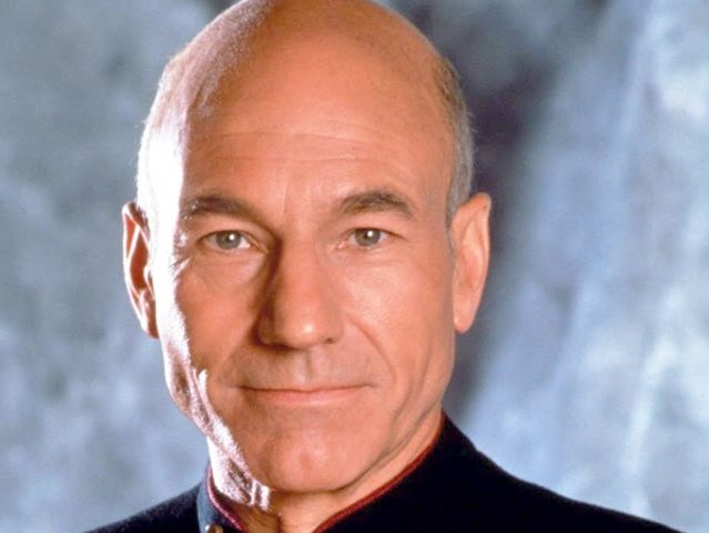 What was Jean-Luc Picard's designation when he was assimilated?